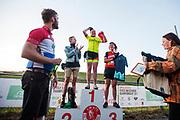 De winnaars in de categorie vrouwen. In Nieuwegein wordt het NK Fietskoerieren gehouden. Fietskoeriers uit Nederland strijden om de titel door op een parcours het snelst zoveel mogelijk stempels te halen en lading weg te brengen. Daarbij moeten ze een slimme route kiezen.<br /> <br /> The female winners. In Nieuwegein bike messengers battle for the Open Dutch Bicycle Messenger Championship.