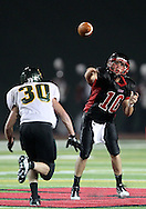 Linn-Mar's Mark Atwater (10) throws the ball over Kennedy's Joshua Jahlas (30) during the game between Cedar Rapids Kennedy and Linn-Mar at Linn-Mar Stadium in Marion on Friday evening, September 2, 2011. It was 35-7 Linn-Mar at halftime.