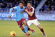 Duane Holmes of Scunthorpe United and David Buchanan of Northampton Town during the EFL Sky Bet League 1 match between Northampton Town and Scunthorpe United at Sixfields Stadium, Northampton, England on 14 January 2017. Photo by Andy Handley.