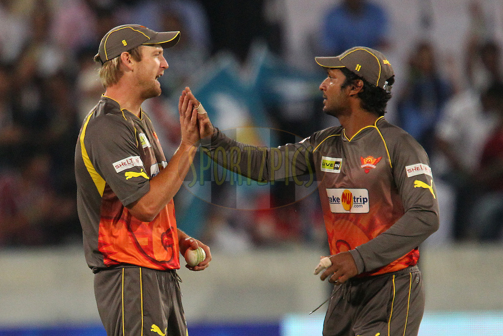 Cameron White and Kumar Sangakkara celebrate the wicket of Manish Pandey during match 3 of of the Pepsi Indian Premier League between The Sunrisers Hyderabad and The Pune Warriors held at the Rajiv Gandhi International  Stadium, Hyderabad  on the 5th April 2013..Photo by Ron Gaunt-IPL-SPORTZPICS..Use of this image is subject to the terms and conditions as outlined by the BCCI. These terms can be found by following this link:..http://www.sportzpics.co.za/image/I0000SoRagM2cIEc