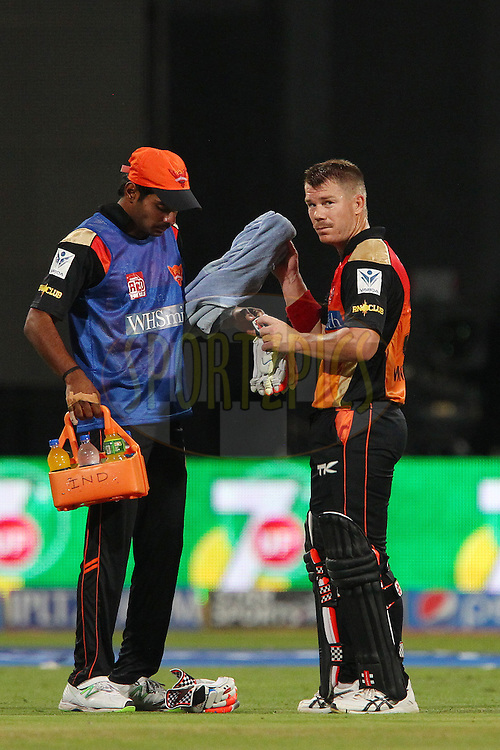 David Warner of the Sunrisers Hyderabad changes gloves during match 24 of the Pepsi Indian Premier League Season 2014 between the Royal Challengers Bangalore and the Sunrisers Hyderabad held at the M. Chinnaswamy Stadium, Bangalore, India on the 4th May  2014<br /> <br /> Photo by Ron Gaunt / IPL / SPORTZPICS<br /> <br /> <br /> <br /> Image use subject to terms and conditions which can be found here:  http://sportzpics.photoshelter.com/gallery/Pepsi-IPL-Image-terms-and-conditions/G00004VW1IVJ.gB0/C0000TScjhBM6ikg