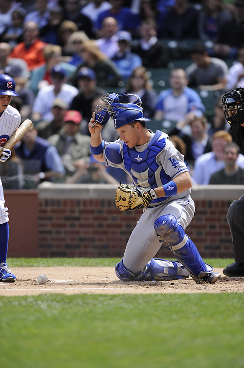 CHICAGO - MAY  04:  A.J. Ellis #17 of the Los Angeles Dodgers catches against the Chicago Cubs on May 4, 2012 at Wrigley Field in Chicago, Illinois.  The Cubs defeated the Dodgers 5-4.  (Photo by Ron Vesely)   Subject:  A.J. Ellis