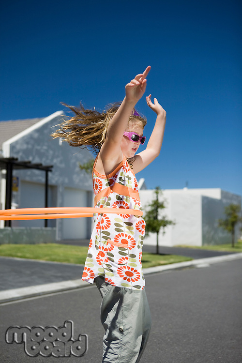South Africa Cape Town girl playing with plastic hoop