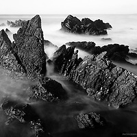 Using a ND filter enabling a long exposure on the jagged rocks of Punta de Lobos during the golden, misting the turbulent ocean against rocks.