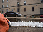 10 MAY 2019 - DAVENPORT, IOWA: A pump discharges water from a flooded building onto a street in Davenport. The Davenport riverfront and downtown flooded on 30 April 2019 when a levee on the Mississippi River failed, allowing the river to flow into Davenport. Parts of downtown are still flooded, nearly two weeks after the levee failed. The river crested at 22.7 feet above flood stage, setting a new record. The previous highest flood stage was 22.63, set in 1993.         PHOTO BY JACK KURTZ