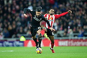 Sunderland forward Jermain Defoe (#18) makes a tackle on Liverpool midfielder Emre Can (#23) during the Premier League match between Sunderland and Liverpool at the Stadium Of Light, Sunderland, England on 2 January 2017. Photo by Craig Doyle.
