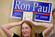"""May 22, 2008 - Phoenix, AZ: A woman waits to hear Ron Paul speak in Phoenix Thursday. About 850 people crowded into the ballroom at the Pointe Hilton Squaw Peak Resort in Phoenix, AZ, to hear Republican presidential hopeful Ron Paul speak. Although Arizona Sen. John McCain is the """"presumptive"""" Republican candidate for president, Texas Congressman Ron Paul is staying in the race and actively campaigning for the Presidency. Photo by Jack Kurtz"""