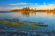 Rocky shoreline of Setting Lake at sunset<br />Setting Lake Wayside Park near Wabowden<br />Manitoba<br />Canada