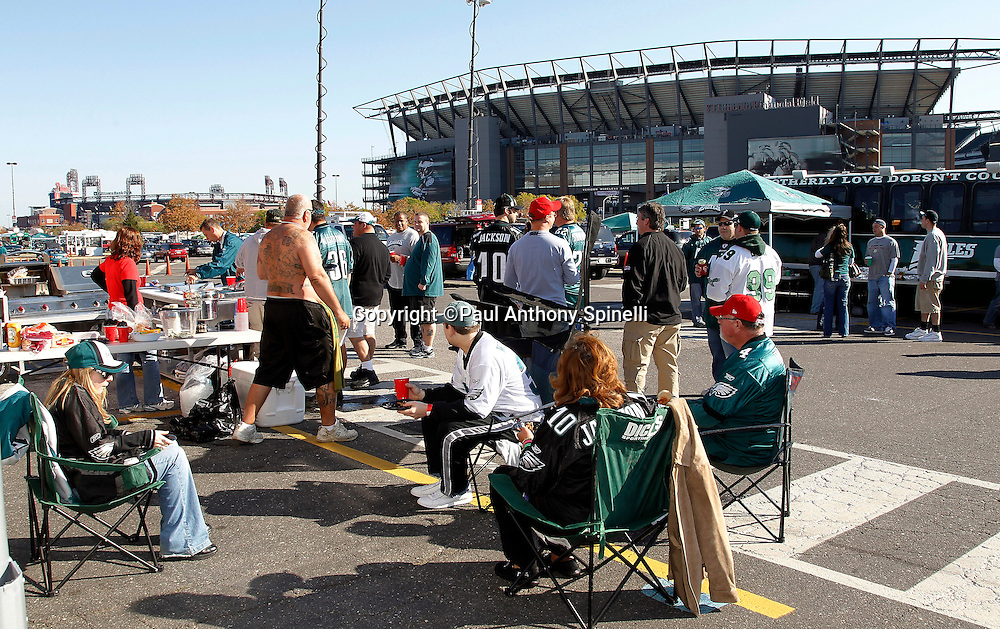 Fans tailgate prior to the Philadelphia Eagles NFL week 6 football game against the Atlanta Falcons on Sunday, October 17, 2010 in Philadelphia, Pennsylvania. In the background are Lincoln Financial Field (right), home of the Eagles, and Citizens Bank Park (left), home of the Philadelphia Phillies where the baseball team will be playing game two of the MLB NLCS (National League Championship Series) after the Eagles game. The Eagles won their game 31-17. (©Paul Anthony Spinelli)