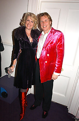 THEO & LOUISE FENNELL at a party hosted by jeweller Theo Fennell and Dominique Heriard Dubreuil of Remy Martin fine Champagne Cognac entitles 'Hot Ice' held at 35 Belgrave Square, London, W1 on 26th October 2004.<br /><br />NON EXCLUSIVE - WORLD RIGHTS