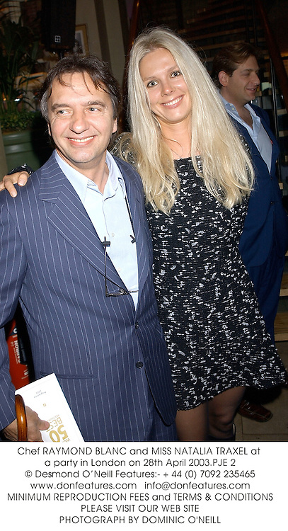 Chef RAYMOND BLANC and MISS NATALIA TRAXEL at a party in London on 28th April 2003.	PJE 2