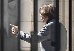 © Licensed to London News Pictures. 21/07/2020. London, UK. American actor Johnny Depp takes a cigarette and coffee break before court starts at the High Court in London where he is in a legal dispute with UK tabloid newspaper The Sun over allegations he assaulted his former wife, Amber Heard. Photo credit: Peter Macdiarmid/LNP