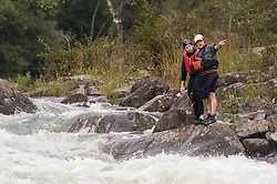 Unidentified whitewater kayakers scout out the rapids at Pillow Rock on the Gauley River during American Whitewater's Gauley Fest weekend. The upper Gauley, located in the Gauley River National Recreation Area is considered one of premier whitewater rivers in the country.