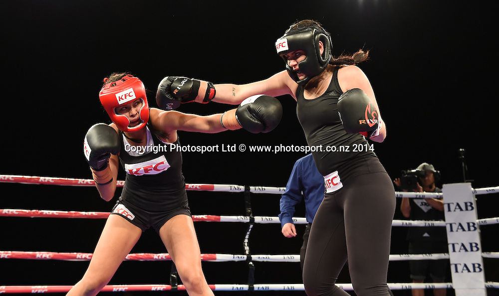 Millie Elder-Holmes v Frankie Adams (Red). KFC Fight For Life Boxing by Duco Events at the Claudelands Arena in Hamilton. New Zealand. Saturday 6 December 2014. Photo: Andrew Cornaga/www.photosport.co.nz.