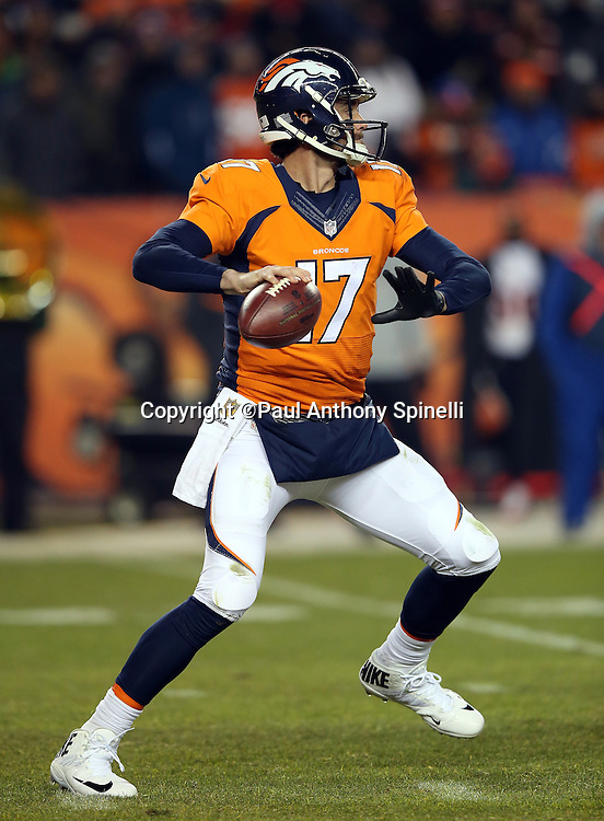 Denver Broncos quarterback Brock Osweiler (17) throws a second quarter pass for a gain of 9 yards during the 2015 NFL week 16 regular season football game against the Cincinnati Bengals on Monday, Dec. 28, 2015 in Denver. The Broncos won the game in overtime 20-17. (©Paul Anthony Spinelli)