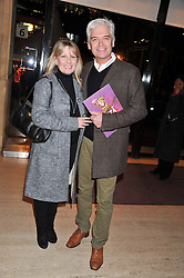 PHILLIP SCHOFIELD and his wife STEPHANIE at Cirque du Soleil's VIP night of Kooza held at the Royal Albert Hall, London on 8th January 2013.