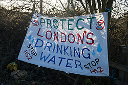 Harefield, UK. 19 January, 2020. A banner at Colne Valley wildlife protection camp calls for London's drinking water to be protected. Activists from Extinction Rebellion, Stop HS2 and Save the Colne Valley are attending a 'Stand for the Trees' event timed to coincide with tree felling work for HS2. Bailiffs acting for HS2 have been evicting Stop HS2 activists from their Harvil Road wildlife protection camp for the past week and a half. 108 ancient woodlands are set to be destroyed by the high-speed rail link.