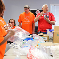 Joe Lukas, with the North Mississippi Chapter of the American Red Cross Disaster & Operations Services, holds up a bag of personal hygiene pruducts from his storage that will be packed into a comfort kit by Arc members Friday morning at the American Red Cross office in Tupelo Friday morning. The Arc members also donated some supplies for kits that are distributed during emergencies and natural disasters. The Tupelo office of The American Red Cross have gone through aal their comfort kits with so many recent disasters.