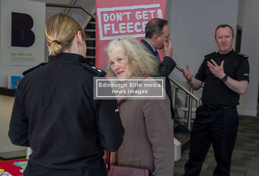 Pictured: Pictured: Inspector Phillipa Boyd chats to a customerr about the new campaign<br />Police Scotland is warning that anyone can be a victim of doorstep crime after householders lost hundreds of thousands of pounds to scammers. <br /><br />The Shut Out Scammers campaign was launched today at the Clydesdale Bank, George Street, Edinburgh.  Chief Superintendent John McKenzie was joined by colleagues from Police Scotland, Clydesdale Bank, Care and Repair Edinburgh, Crime Stoppers and Trading Standards.<br /><br />Ger Harley   EEm 14 APRIL 2019