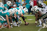 The Miami Dolphins offensive line gets set to snap the ball at the line of scrimmage opposite the New York Jets defensive line during the NFL week 9 regular season football game against the New York Jets on Sunday, Nov. 4, 2018 in Miami Gardens, Fla. The Dolphins won the game 13-6. (©Paul Anthony Spinelli)