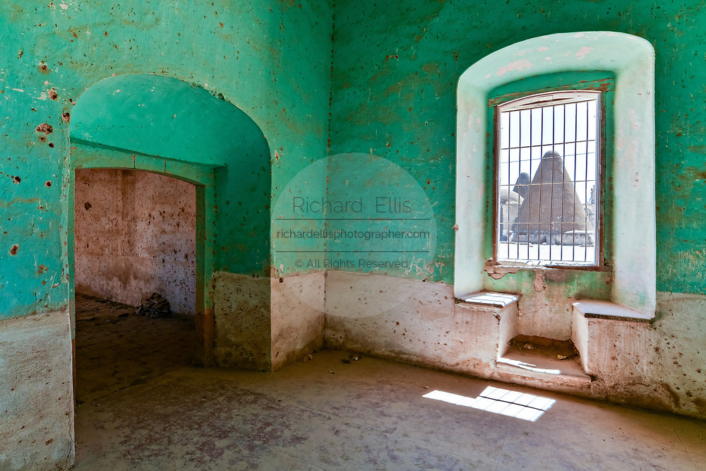 A view of the pyramid shaped granaries from inside a crumbling room at the fading Hacienda de Jaral de Berrio in Jaral de Berrios, Guanajuato, Mexico. The abandoned Jaral de Berrio hacienda was once the largest in Mexico and housed over 6,000 people on the property and is credited with creating Mescal.