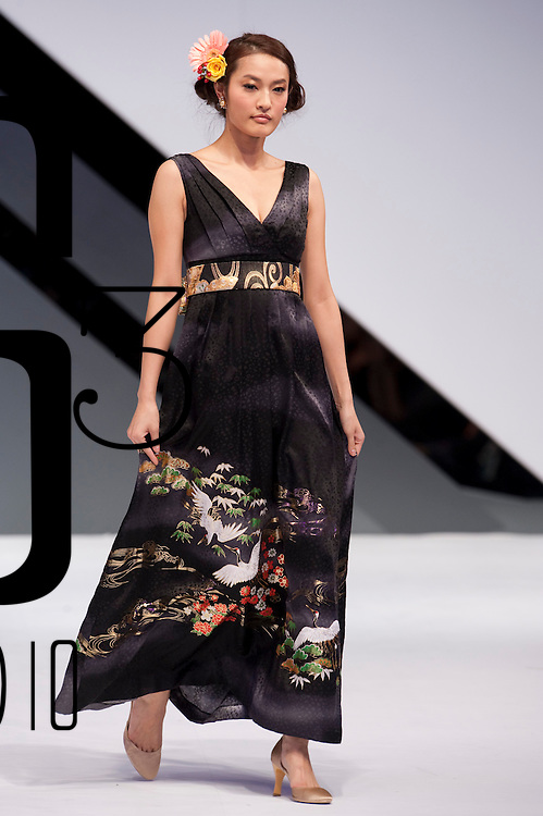 HONG KONG - JANUARY 20:  A model showcases designs by Naoko Tsuruta of Japan  on the catwalk during the International Fashion Designers' Show I as part of the  Hong Kong Fashion Week Fall/Winter 2010 on January 20, 2010 in Hong Kong.  Photo by Victor Fraile / studioEAST