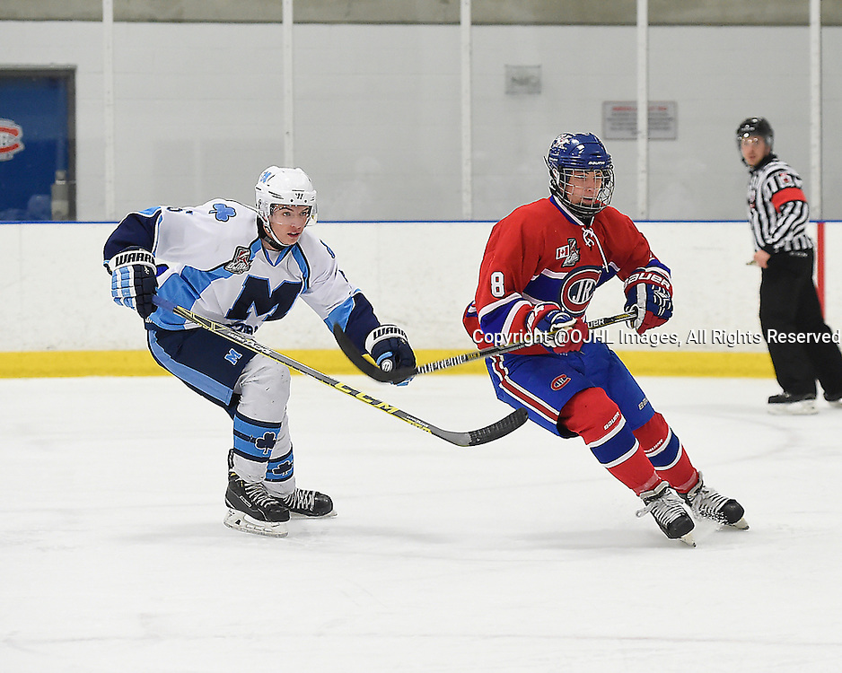 TORONTO, ON - Oct 4, 2015 : Ontario Junior Hockey League game action between St. Michael's and Toronto, Mark Paolini #5 of the St. Michael's Buzzers and Lee Lapid #8 of the Toronto Jr. Canadiens pursue the play during the third period.<br /> (Photo by Andy Corneau / OJHL Images)