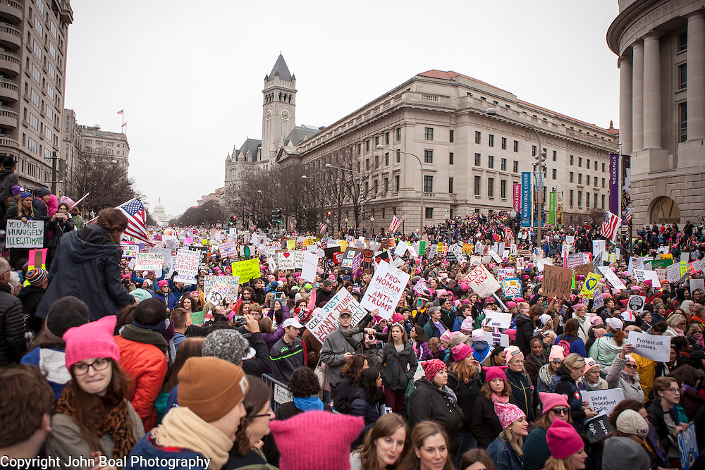 The Women's March on Washington clogged Pennsylvania avenue, filing past Trump International Hotel (clock tower), where an anticipated 200,000 people turned into an estimated 500,000 to 1 million people, on Saturday, January 21, 2017.  John Boal Photography