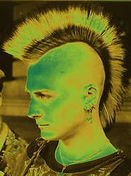 Portrait of young man with Mohican haircut and nose ring,