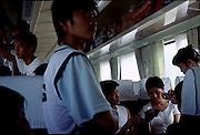 Playing cards on a train to Wulumuqi, China. 2007