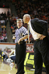 Head coach Dave Leitao consults with a ref during the Virginia Tech game.  The Wahoos beat the Hokies 54-49 in Blacksburg, for Leitao's first ACC road win.