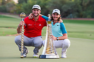 Jon Rahm of Spain ( left) and Tommy Fleetwood of England ( right) pose with their trophies after the European Tour DP World Championship at Jumeirah Golf Estates, Dubai, UAE on 19 November 2017. Photo by Grant Winter.