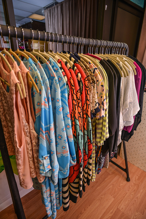 Racks of clothing for sale at NOTO Boutique.