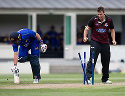 Otago Volts' Neil Broom, left, just gets home safely as Canterbury's Tim Johnston looks on in the Ford Trophy one-day domestic cricket match at the University of Otago Oval, Dunedin, New Zealand, Saturday, January 27, 2018. Credit:SNPA / Adam Binns ** NO ARCHIVING**