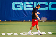 Bobby Reynolds of the Washington Kastles reacts after a miss-hit during a match against the Springfield Lasers at Mediacom Stadium on July 11, 2012 in Springfield, Missouri. (David Welker/www.Turfimages.com).