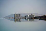 Hotels and a reflection in the Dead Sea, Israel as seen from North