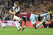 West Bromwich Albion midfielder (on loan from Fulham) Stefan Johansen (6) battles for possession  withAston Villa striker(on loan from Chelsea) Tammy Abraham (18) who falls acrobatically during the EFL Sky Bet Championship play-off second leg match between West Bromwich Albion and Aston Villa at The Hawthorns, West Bromwich, England on 14 May 2019.