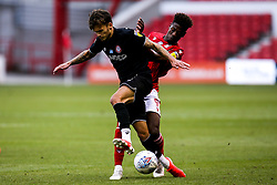 Jamie Paterson of Bristol City is tackled by Nuno Da Costa of Nottingham Forest - Mandatory by-line: Robbie Stephenson/JMP - 01/07/2020 - FOOTBALL - The City Ground - Nottingham, England - Nottingham Forest v Bristol City - Sky Bet Championship
