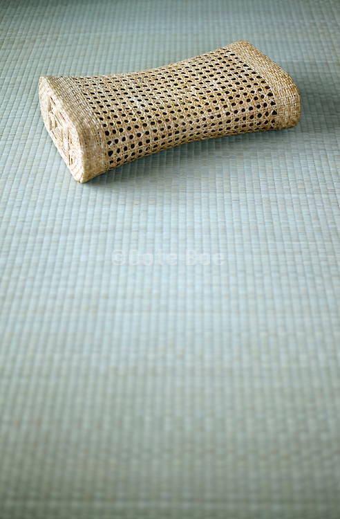 Asian style summer Bamboo head cushion on a tatami floor
