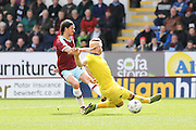 Burnley midfielder George Boyd (21) with a shot during the Sky Bet Championship match between Burnley and Leeds United at Turf Moor, Burnley, England on 9 April 2016. Photo by Simon Davies.