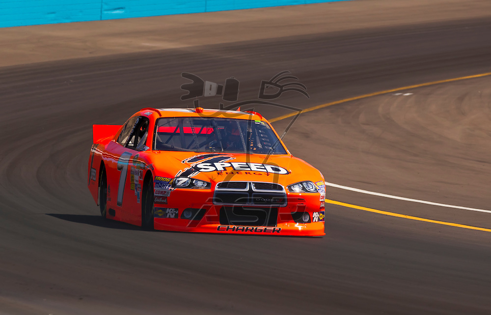AVONDALE, AZ - MAR 03, 2012:  Robby Gordon (7) brings his NASCAR Sprint Cup car through turn 4 during qualifying for the Subway Fresh Fit 500 race at the Phoenix International Raceway in Avondale, AZ.