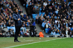 Tottenham Hotspur Manager, Andre Villas Boas cuts a dejected figure - Photo mandatory by-line: Dougie Allward/JMP - Tel: Mobile: 07966 386802 24/11/2013 - SPORT - Football - Manchester - Etihad Stadium - Manchester City v Tottenham Hotspur - Barclays Premier League