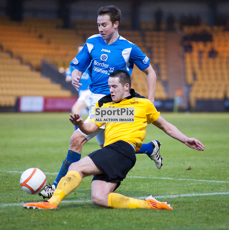 Marc McNulty (9) gets a cross in despite the attention of Chris Higgins, Livingston v Queen of the South, SFL Division 1, Braidwood Motor Company Stadium, Monday 21st January 2012