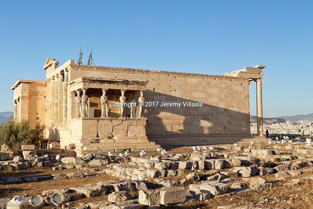 The Erechtheion in the Acropolis of Athens. In the foreground are the foundations of the Old Temple of Athena Polias.