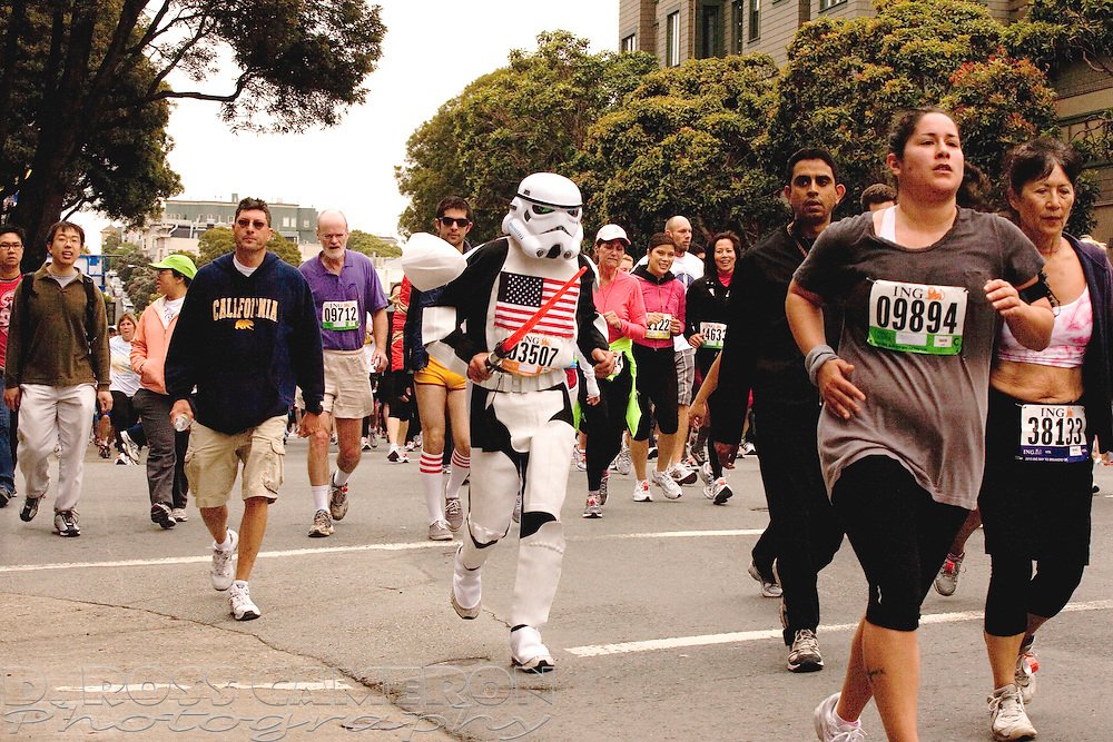 "An unidentified runner, costumed as an Imperial Storm Trooper from the George Lucas ""Star Wars"" film series, jogs along Fell Street at the 99th running of the Bay to Breakers 12K race, Sunday, May 16, 2010 in San Francisco. (Photo by D. Ross Cameron)"