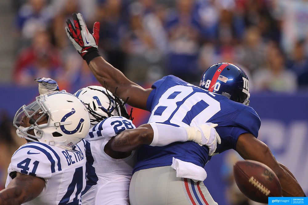 Victor Cruz, New York Giants, receives pass interference while attempting a catch from quarterback Eli Manning during the New York Giants V Indianapolis Colts, NFL American Football Pre Season match at MetLife Stadium, East Rutherford, NJ, USA. 18th December 2013. Photo Tim Clayton