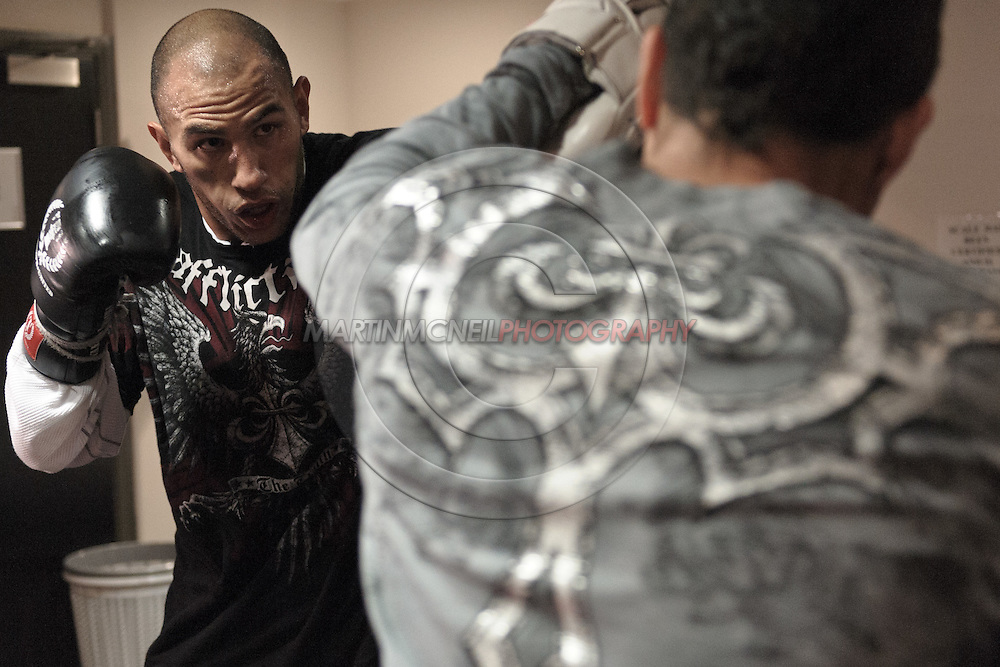 MANCHESTER, ENGLAND, NOVEMBER 11, 2009: Brandon Vera (left) performs focus mitt striking drills during the open work-outs for UFC 105 at the Crowne Plaza Hotel in Manchester, England on November 11, 2009.