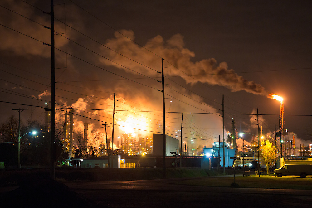 """December 19th, 2013, Norco Louisiana, A flare from the Shell Refinery illuminates the sky. Norco is part of a corridor between Baton Rouge and New Orleans known to those in Industry and the 'petrochemical corridor and to locals as """"cancer alley""""."""