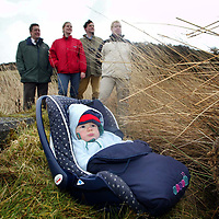Steve Sankey (left), Chief Exec of SWT and Stuart Glen (right) SWT Membership Development Manager with the trust's 20,000th member Andrew and Lucy Aitchison with son Tom....They are pictured at Cullaloe Wildlife Reserve in Fife...<br />