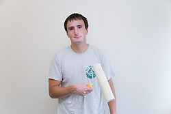 Bulgarian painter and decorator with paint roller,